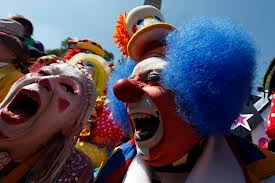 This is the least scariest picture I could find of an insane clown.  No wonder clowns give kids nightmares!